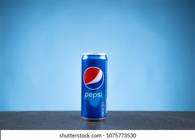 KUALA LUMPUR, MALAYSIA - APRIL 24,2018 : Pepsi 330 ml can against gradient blue background. Pepsi is a carbonated soft drink produced by PepsiCo.