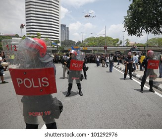 KUALA LUMPUR, MALAYSIA - APRIL 28: Riot police in formation at the protest rally organized by the coalition for clean and fair election on April 28, 2012 in Dataran Merdeka, Kuala Lumpur, Malaysia.