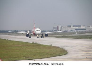 KUALA LUMPUR, MALAYSIA - APRIL 28, 2017 : Aircraft of budget airline Airasia taxing on tarmac of KLIA 2 airport.
