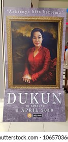 """KUALA LUMPUR, MALAYSIA - APRIL 4, 2018: Dukun (Malay: """"Shaman"""") movie poster; is a 2018 Malaysian horror film based on the true story of gruesome murder of a former Malaysian politician"""