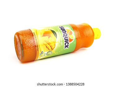 Kuala Lumpur, Malaysia - April 4, 2019 - A bottle of Sunquick brand of concentrated mixed mango flavor juices isolated on white background