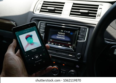 KUALA LUMPUR, MALAYSIA - APRIL 4TH, 2018 : Spotify Swedish music service that offers legal streaming music. It provides high quality Audio. User browse trending music sync with Car Bluetooth Audio.