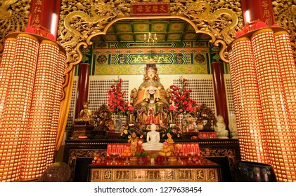 KUALA LUMPUR, MALAYSIA — APRIL 5, 2018. Thean Hou Buddhist temple is dedicated to the goddess Tian Hou, whose statue sits on the altar in this room decorated in red and gold.