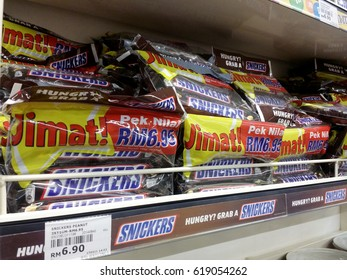 KUALA LUMPUR, MALAYSIA - APRIL 7, 2017: Close up view of Snickers on the supermarket shelf.Snickers bars are produced by Mars Incorporated.