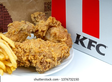 KUALA LUMPUR, MALAYSIA - APRIL 8, 2019 : KFC Kentucky Fried Chicken Fast Food Meal on white background.  Selective focus and crop fragment