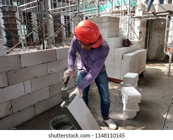 KUALA LUMPUR, MALAYSIA -APRIL 9, 2018: Bickwall is being erected by construction workers at construction sites. These bricks will be plastered as the final finish before being painted.
