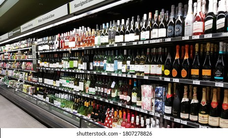 Kuala Lumpur, Malaysia - Aug 2020: Wide range brand of bottle or can alcoholic beverage (hard liquor, beer, wine) in shopping shelf. Imported liquor and alcohol. Non Halal.