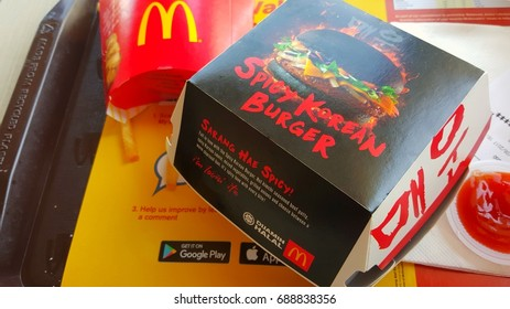KUALA LUMPUR, MALAYSIA - AUG 2ND, 2017: McDonald's Spicy Korean Burger.  This is the first McDonald's Malaysia burger to use charcoal buns in place of the classic sesame-sprinkled buns.