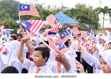 Kuala Lumpur, Malaysia- AUG 3, 2017: Malaysian primary students with Malaysian Flag during the celebration of Hari Kemerdekaan, the Independence Day of Malaysia.