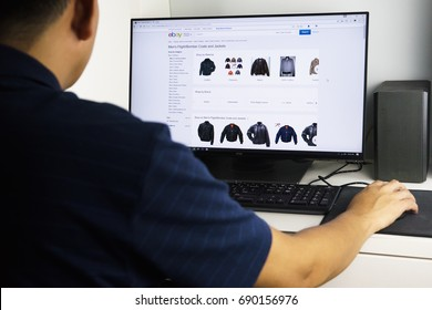 KUALA LUMPUR, MALAYSIA - AUG 4TH, 2017: Unidentified man browsing men's cloth on eBay home page. Ebay is a an online auction and shopping website worldwide.