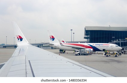 Kuala Lumpur, Malaysia - August 10 2019: A photo of a Malaysia Airlines Boeing 737 and the wing tip with Malaysia Airlines logo with hazy sky at the back