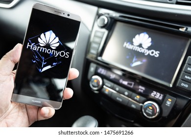 KUALA LUMPUR, MALAYSIA, August, 11, 2019: Huawei officially announced its new operating system, HarmonyOS. Illustrative visual of HarmonyOS on smat phone and vehicle car honor smart screen