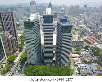KUALA LUMPUR, MALAYSIA - AUGUST 15, 2017 : Aerial view of Kuala Lumpur near Kampung Baru during sunny day. Kuala Lumpur was hosted 29th Sea Games for this year.