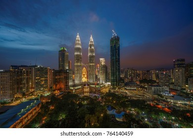 Kuala Lumpur, Malaysia - August 15, 2017 : Petronas Twin Towers (fondly known as KLCC) at sunset blue hour seen from the Skybar at Traders Hotel.