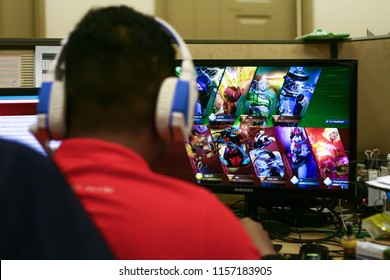 Kuala Lumpur, Malaysia - August 16, 2018: Man watching e-sport online games Dota 2 The International 2018