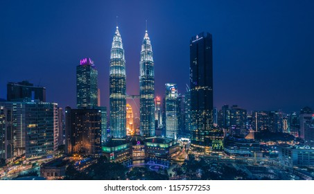KUALA LUMPUR, MALAYSIA - AUGUST 16, 2018: The Petronas Twin Towers in Kuala Lumpur, the capital of Malaysia, during the blue hour at evening with bright lights in the skyscraper and the buildings