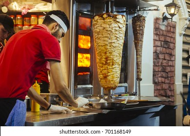 KUALA LUMPUR, MALAYSIA - AUGUST 19, 2017 : Arab people sell delicious shawarma sandwich on Bukit Bintang street. Shawarma is a sandwich especially of sliced lamb or chicken wrap by pita with vegetable