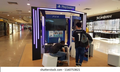 Kuala Lumpur / Malaysia - August 20 2018: Staff setting up Sony Playstation booth in Midvalley