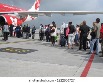 Kuala Lumpur / Malaysia - August 2010: passengers queue up to get on board, AirAsia flight taking off