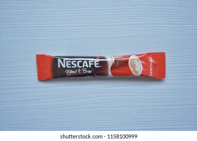 """KUALA LUMPUR, MALAYSIA - AUGUST 2018 : Closeup on sachets of Nestle Nescafe """"Original"""" flavour 3 in 1 coffee on the table.Nestle first introduced their flagship coffee brand in Switzerland on 1 April"""