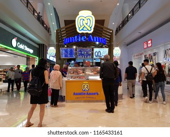 Kuala Lumpur, Malaysia. August 23, 2018. Auntie Anne's kiosk at concourse level of Suria Mall KLCC, is known for hand-baked pretzels to be enjoyed with a refreshing lemonade