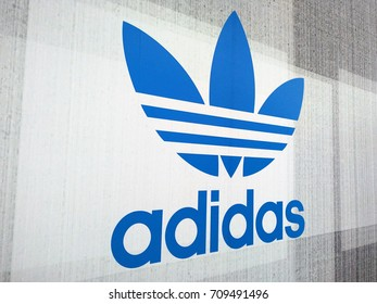 KUALA LUMPUR, MALAYSIA - AUGUST 26, 2017: A sign for an Adidas retail store in Suria KLCC, Adidas is a German corporation that designs footwear and clothing.