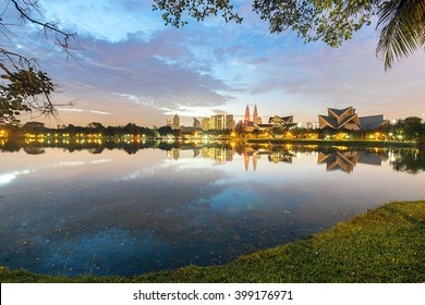 KUALA LUMPUR, MALAYSIA. AUGUST 27, 2015. View and reflection during dramatic sunrise at Titiwangsa Lake Garden. Located in the north-eastern fringe of Kuala Lumpur.