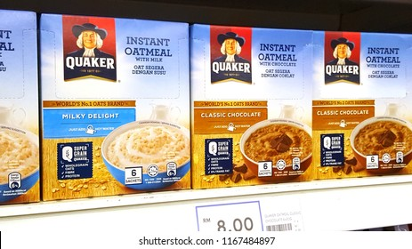 Kuala Lumpur, Malaysia- August 28, 2018: Quaker instant oatmeal boxes on the supermarket shelves. Quaker is an American food conglomerate based in Chicago.