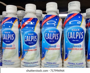 KUALA LUMPUR, MALAYSIA - AUGUST 28, 2017: Calpis Smooth Cultured Milk Drink on Store shelf, Calpis is made from nonfat milk which fermented slowly by adding microorganisms including lactobacilli.