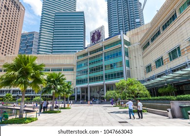 KUALA LUMPUR, MALAYSIA - AUGUST 3: People walks in KLCC park and Suria KLCC shopping mall on the background on August 3, 2016 in Kuala Lumpur, Malaysia.