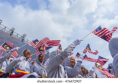 KUALA LUMPUR, MALAYSIA - AUGUST 31, 2016: Student waving Malaysia flag 'Jalur Gemilang' during Independent Day celebration in Kuala Lumpur.