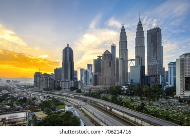 KUALA LUMPUR, MALAYSIA - AUGUST 31, 2017: A burning sky view of Kuala Lumpur skyline featuring the famous twin towers. The twin towers were officially opened in August 1999.