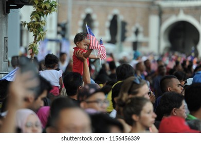 Kuala Lumpur, Malaysia, August 31th 2017, a kid shows patriotism while holding Malaysian flag during the celebration of National Day at Dataran Merdeka.
