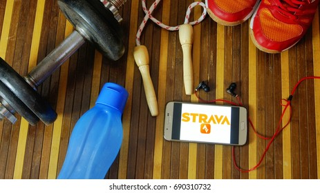 KUALA LUMPUR, MALAYSIA - AUGUST 5, 2017 : Fitness and healthy concept with smartphone to stay fit using Fitness Apps Strava. Lose weight by tracking your calorie intake quickly and easily