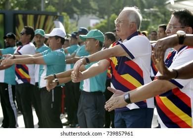 KUALA LUMPUR, MALAYSIA - AUGUST 8, 2017. Malaysia's Prime Minister, Najib Razak warm up before take part in a Kuala Lumpur SEA Games torch run in Kuala Lumpur.