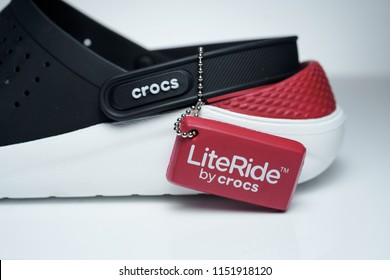 KUALA LUMPUR, MALAYSIA - August 8th, 2018 : Pair of new Crocs foam LiteRide on gray background. Crocs is a worldwide company selling comfortable shoes