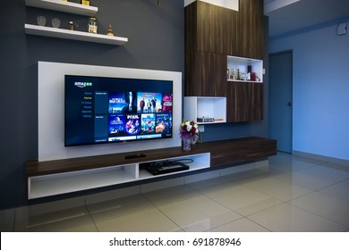 KUALA LUMPUR, MALAYSIA - AUGUST 8TH, 2017 : Modern lifestyle with SONY Android TV to stay connected & browsing media using favourite Apps. Tv display Spotify music apps