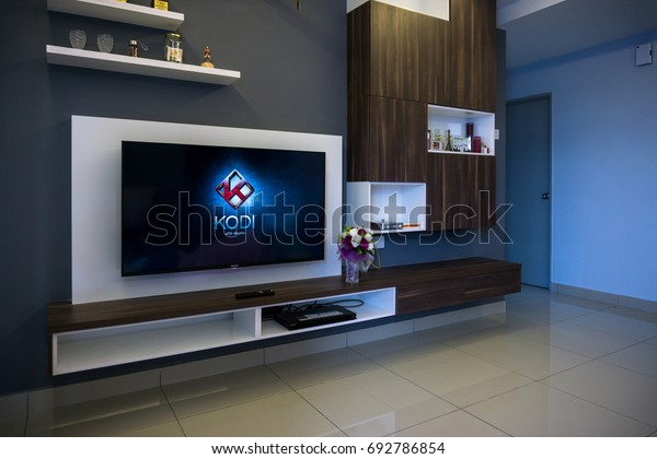 KUALA LUMPUR, MALAYSIA - AUGUST 8TH, 2017 : Modern lifestyle with SONY Android TV to stay connected & browsing media using favourite Apps. Tv display Kodi apps