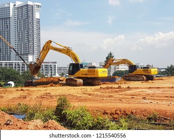 KUALA LUMPUR, MALAYSIA -AUGUST 9, 2017: Heavy machinery doing earthwork at the construction site. Works carried out before building construction starts to get required levels.