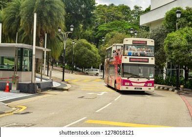 Kuala Lumpur, Malaysia, circa 2019. Front shot of a Kuala Lumpur hop on hop off tourist open bus on the street. Display on the bus is showing the next stop as twin towers.
