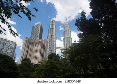 KUALA LUMPUR, MALAYSIA - CIRCA JANUARY 2015: Petronas Towers. Petronas Towers, also known as Menara Petronas is the tallest buildings in the world from 1998 to 2004.