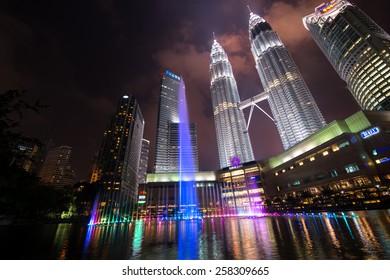 KUALA LUMPUR, MALAYSIA - CIRCA JANUARY 2015: Petronas Twin Towers at night. Petronas Twin Towers were the tallest buildings (452 m) in the world from 1998 to 2004.