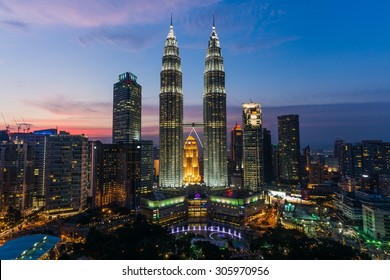 KUALA LUMPUR, MALAYSIA Circa June 2014: The petronas towers at sunset seen from the traders skybar