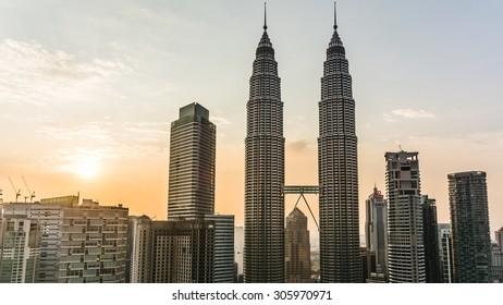 KUALA LUMPUR, MALAYSIA Circa June 2014: The petronas towers at sunset seen from the traders skybar