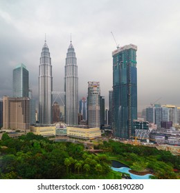 KUALA LUMPUR, MALAYSIA - CIRCA MAY 2017: Petronas Twin Towers (fondly known as KLCC) and the surrounding buildings in stormy weather with overcast sky