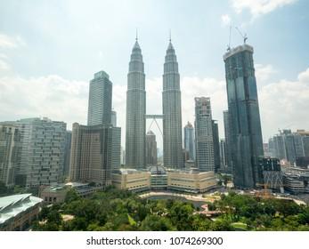 KUALA LUMPUR, MALAYSIA - CIRCA MAY 2017:  Top view of Kuala Lumper skyline with famous Petronas Twin Towers (fondly known as KLCC) in Kuala Lumpur, Malaysia.