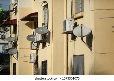 Kuala Lumpur, Malaysia- Circa May 2019 : Astro satellite TV receiver pictured on state government low cost house at Kuala Lumpur. Astro is the only satellite TV provider in Malaysia. - Image