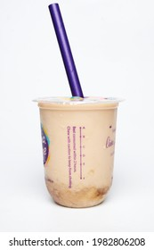 """""""Kuala Lumpur, Malaysia- Circa May, 2021: A picture of Chatime tea drink container with best consumed within 2 hours, caution word, A to F level and biodegradable straw."""