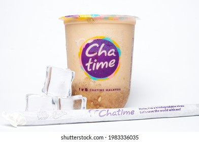 """""""Kuala Lumpur, Malaysia- Circa May, 2021: A picture of Chatime water container with brown sugar tea and oat. Also ice cube and biodegradable straw insight"""