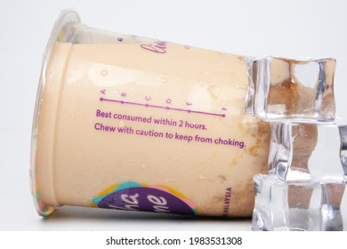 """""""Kuala Lumpur, Malaysia- Circa May, 2021: A picture of Chatime tea drink container with best consumed within 2 hours, caution word, A to F level and ice insight."""